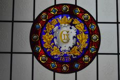 Stained Glass window - The Chapel Interior - Frederiksborg Castle. Stained Glass Window commemorating Christain IX in The ornate and beautiful Chapel Interior at royalty free stock photography