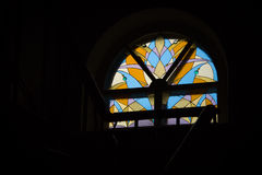 Stained glass window. In the dark interior Royalty Free Stock Images
