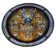 Stained glass window depicting the ancient coat of arms on the w Stock Photos