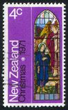 Stained Glass Window Depicting Angel and Woman. NEW ZEALAND - CIRCA 1971: stamp printed by New Zealand, shows Stained Glass Window Depicting Angel and Woman royalty free stock images