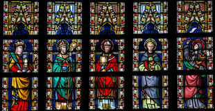 Stained glass window depicting Catholic Saints Stock Photos
