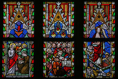 Stained glass window depicting Scenes in the Life of Jesus Chris Stock Photo