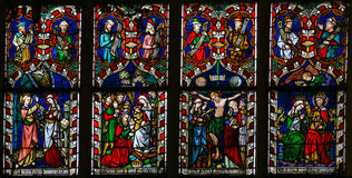Stained glass window depicting scenes in the life of Mother Mary. In the Cathedral of Sint-Truiden in Limburg, Belgium Royalty Free Stock Images
