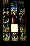 Stained glass window detail with Biblical scene Royalty Free Stock Photography