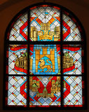Stained glass window with emblem. Of the city in ancient castle Royalty Free Stock Photos