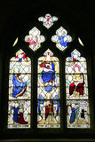 Stained glass window, Eyam, Derbyshire. A memorial stained glass window in St. Lawrence parish church at the plague village of Eyam, Derbyshire, England, UK Stock Photos