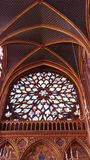 Stained glass window in gothic cathedral stock photo