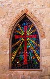 Gothic style church window with stained glass/ red cross made of Stock Image