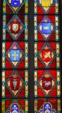 Stained Glass window with heraldic crests - The Chapel Interior - Frederiksborg Castle. Stained Glass Window with heraldic crests in The ornate and beautiful stock images