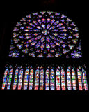 Stained Glass Window inside Notre-Dame Cathedral Stock Photos