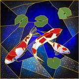 Stained-glass window with Japanese fishes royalty free stock image