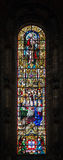 Stained glass window from Jeronimos church in Lisbon, Portugal Royalty Free Stock Photo