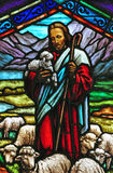 Stained glass window with Jesus stock photo