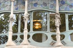 Stained glass window with lit chandelier inside of a building of Gaudi in Barcelona (Spain) Royalty Free Stock Photos