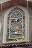 Stained glass window with name of God in a mosque, Istanbul Royalty Free Stock Photography