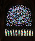 Stained glass window in Notre dame Stock Image