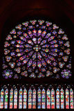 Stained glass window in Notre dame. Cathedral, Paris, France Royalty Free Stock Photo