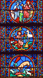 Stained glass window in the Notre Dame cathedral of Paris, Royalty Free Stock Image
