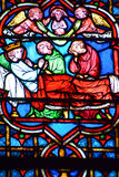 Stained glass window in the Notre Dame cathedral of Paris, Royalty Free Stock Photography