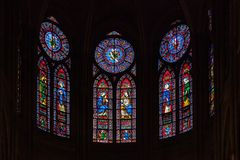 Stained glass window in Notre dame de Paris stock image