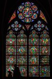 Stained glass window in Notre dame de Paris stock photo