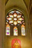 Stained-glass window in old  Catholic temple. Royalty Free Stock Photos