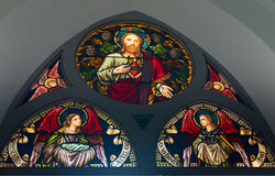 Stained-glass window in old church building Royalty Free Stock Image