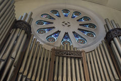 Stained glass window and organ pipes Royalty Free Stock Image