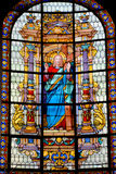 Stained glass window. PARIS, FRANCE - OCTOBER 19: Stained glass window in Church of Saint-Roch is a late Baroque church in Paris, dedicated to Saint Roch in Stock Photography