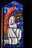 Stained glass window. Pray angel vibrance stock photos
