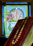 Stained Glass Window with Prayer Beads and Vintage Book Stock Photos