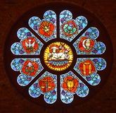 Stained glass window. A round stained glass window with the sun coming through it Royalty Free Stock Images