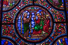 Stained glass window with saints stock photography