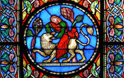Stained glass window Samson slaying the lion. Stained glass window depicting the story of Samson slaying the lion Royalty Free Stock Images