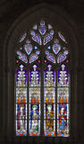 Stained-glass window in Seville cathedral, Spain Royalty Free Stock Images