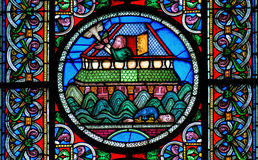 Stained glass window depicting Noahs Ark on the water Royalty Free Stock Images