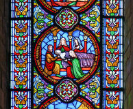Stained glass window showing the death of the fiirst born Stock Images