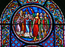 Stained glass window showing the fall of the walls of Jericho Stock Photo