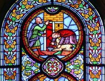 Stained glass window showing sacrificing the lamb Stock Photography