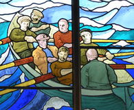 Stained glass picture of men in rowing boat Stock Photos