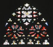 Religious stained glass window in cathedral Royalty Free Stock Images