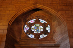 Stained glass window and stonework. Stained glass window and vaulted stonework surround Royalty Free Stock Photos
