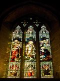 Stained glass window. With streaming sunlight Stock Photography