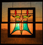 Stained glass in window with sunlight behind Royalty Free Stock Photo