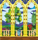 Stained glass window - the view from the balcony of the castle. Across the valley Stock Images