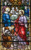 Stained glass window water into wine. This stained glass window was made in 1895 and is found in the cathedral in Quebec city, Canada. The pictre shows the story Royalty Free Stock Image