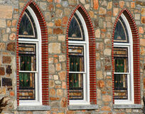 Stained Glass Windows. Three stained glass windows surrounded by beautiful stone Royalty Free Stock Images