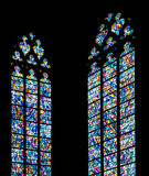 Stained glass windows against a silhouette church wall. Church stained glass windows against a silhouette  wall Royalty Free Stock Photos