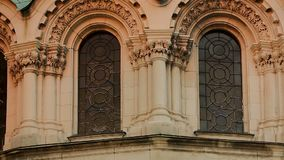 Stained-glass windows of arched form of old cathedral, dome with golden cross. Stock footage stock footage