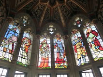 Stained glass windows at Cardiff Castle. Stained glass windows with pictures of people at Cardiff Castle Royalty Free Stock Photos